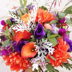 Oranges, reds, and fuchsia oh my!! Bright bridal bouquet for the fearless bride.