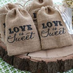"Peach Flower  -  ""Love is Sweet"" Burlap Drawstring Favour Bags, $1.50 (http://www.peachflower.com.au/love-is-sweet-burlap-drawstring-favour-bags/)"
