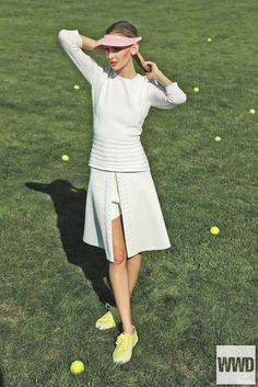 womensweardaily:  Spring 2014 Trend: Game, Set, Chic Photo by George Chinsee Boss' viscose and polyester sweater and Daniel Vosovic's polyester and spandex skort. Superga sneakers.