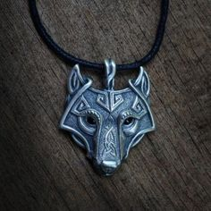 A fine Nordic trinket for only the worthiest vikings! Wear this necklace proud and flaunt your love of knotwork and wolves. Item Details - Materials: Zinc Alloy - Size: Pendant 45x37mm - Color: Antiqu