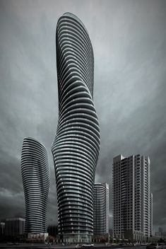 Located in Mississauga, Ontario. Nicknamed the Marilyn Monroe Buildings (for their curvy shapes) Absolute World Towers in Mississauga, Ontario, Canada is a residential condominium twin tower skyscraper complex. Architecture Unique, Futuristic Architecture, Interior Architecture, Classical Architecture, Interior Design, Installation Architecture, Interior Modern, Unique Buildings, Amazing Buildings