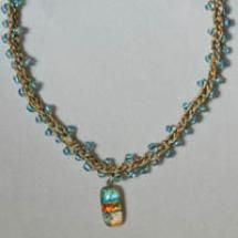 19 Free Crochet Jewelry Patterns You Should Check Out: Beaded Crochet Necklace With Dichroic Glass Pendant