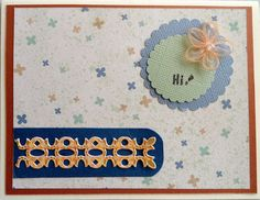 Pretty simple; floral background paper, a short piece of border strip backed by a darker blue, and a couple of circles with Hi and a small flower...
