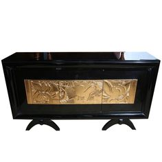 Stunning French Art Deco Black Lacquer/ Carved Giltwood Buffet by Charles Dudouyt, 1940's. 3 Carved Giltwood Center Door Panels, Birds, Foliage in High Relief.    Condition*  Excellent, Newly Refinished  Measurements  height: 41 -1/2   depth: 20 -1/2   width/length: 78 -1/4  SOLD