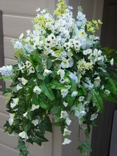 Hanging basket with artificial white petunias & ferns