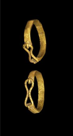 CELTIC GOLD FACETTED RING Circa 1st century BC-1st century AD. A flat-section finger ring with facetted outer face; the hoop open above with attached wire double-loop closure. Gold,