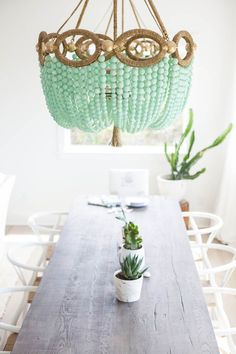 Sea glass inspired chandelier in the dining room Tuesday Tips Decorating your home with beautiful sea glass is a sure way to give your home the perfect coastal feel. You can't go wrong with the coastal blues and greens that sea glass natura… Ro Sham Beaux, Diy Luminaire, Beaded Chandelier, Chandelier Ideas, Chandeliers, Sea Glass Chandelier, Diy Light Fixtures, Sea Glass Colors, Decoration Plante