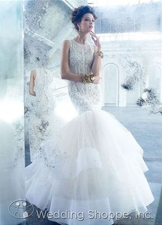 This is a bombshell silhouette! What a perfect fit and flare wedding dress and the sheer bodice is  gorgeous!