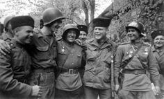 Soviet and American forces meet at the Elbe River near Torgau, Germany.
