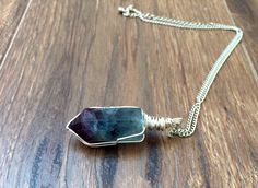 A personal favorite from my Etsy shop https://www.etsy.com/listing/222808178/green-fluorite-om-crystal-wire-wrapped