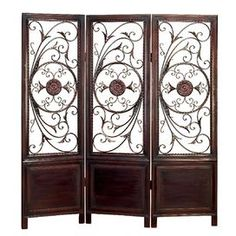 """Scrolling wood and metal room divider.       Product: Room divider    Construction Material: Wood and metal Color: Rustic brown      Features:      Cut-out design allows light to pass through  Three panels     Dimensions: 72"""" H x 60"""" W x 1"""" D"""