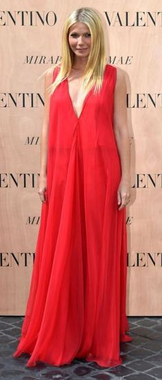 Gwyneth Paltrow slips into daring red plunging gown at Valentino show