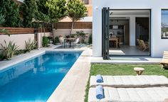 fos villa in Chania is brand new designed villa for up to 10 persons with pool.Fosvilla is located at the entrance of Galatas village distance from the centre of Chania city and enjoys views of the Mediterranean sea and Chania town. Swimming Pool Designs, Swimming Pools, Accordion Doors, Mediterranean Garden, Crete Greece, Folding Doors, Garden Pool, Entrance