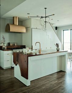 Wood waterfall kitchen island. delight by design: kitchens {clean + simple}