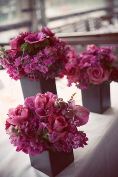 A Sleek Magenta Wedding Rich Burgundy red and cerise pink wedding reception Wedding Flower Arrangements, Floral Centerpieces, Wedding Centerpieces, Floral Arrangements, Purple Centerpiece, Centrepieces, Centerpiece Ideas, Pink Wedding Receptions, Pink Wedding Decorations