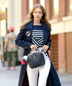 9a52038fa5044 This striped sweater is part of an exclusive capsule collection designed by  Gigi Hadid and Tommy Hilfiger.