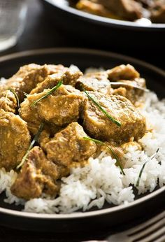 Malaysian Beef Rendang - Tender caramelized beef braised in a phenomenal flavorful & aromatic mix of spices & coconut milk. It's layer upon layer of deliciousness.