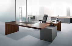 Balanced geometry: the right angle of desk top and side floats on the reduced volume of the pedestal.