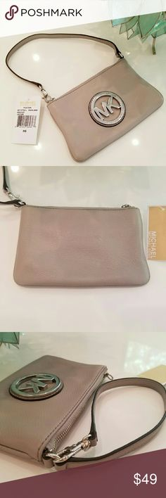"""Michael Kors Fulton Wristlet in Pearl Grey Leather NWT! MK Fulton Wristlet in fabulous pearl grey leather with silver toned hardware! Brand new; price tab from bottom of tag is gone. 7"""" x 4.5"""" with about 7.5"""" strap drop. Michael Kors Bags Clutches & Wristlets"""