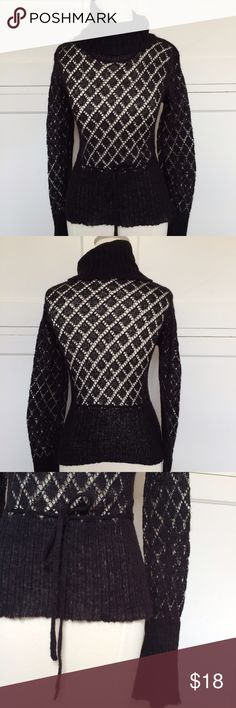 """Black Turtleneck Sweater NO TRADES. OFFERS WELCOME. PLEASE USE THE OFFER BUTTON. I DO NOT NEGOTIATE PRICE IN THE COMMENTS. Black, open-weave turtleneck sweater. Ties at waist. Length is 23"""". 16"""" across at bustline. 56% acrylic, 31% nylon, 14"""" mohair. Has some stretch. Pre-loved, in good condition. Wet Seal Sweaters Cowl & Turtlenecks"""
