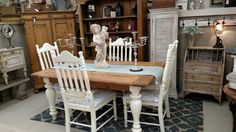 Refinished table top with painted base & chairs...updated fabric on chairs. A Great new look for your dining area!