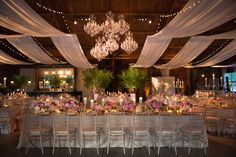 Chandeliers Grouped Together    Photography: Ira Lippke Studios   Read More:  http://www.insideweddings.com/weddings/a-lakeside-black-tie-wedding-with-a-summer-camp-theme/938/