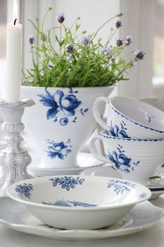Pretty set I haven't seen before--would go well with my other blue roses tableware