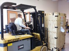 Our new machine is here! Details to follow soon. Realize President Todd Reese is loading it in the building himself.