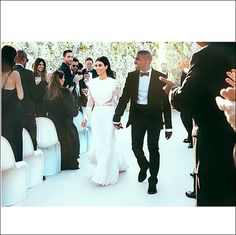 Kim Kardashian, Kanye West Share Wedding Pictures on Instagram, Twitter: See Her Dress, the Kiss and More!