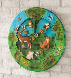 3D Lighted Woodland Recycled Oil Drum Lid Wall Art |  With gorgeous, colorful flowers and 3D woodland animals, this recycled oil drum lid wall art is sure to pop against your siding, porch or even indoors. Each piece is hand-cut and hand-painted for a one-of-a-kind motif. 100 LED string lights back-light the design for 8 hours on/16 off; battery-operated. Recycled Metal Art, Oil Drum, Led String Lights, Woodland Animals, Colorful Flowers, Drums, 3 D, Decorative Plates, Recycling