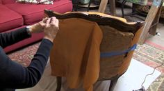 Bobanne Kalkofen, Professor Interior Design at Johnson County Community College demonstrates the process she used to reupholster an old chair. This chair is ...
