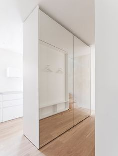 Built-in furniture divides rooms and stark walls can be offset with colourful objects inside the three apartments of this renovated block in Stuttgart. Condo Furniture, Built In Furniture, House Outside Design, House Design, Mirrored Wardrobe Doors, Moderne Pools, Flur Design, Modern Apartment Design, Hallway Designs