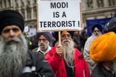 Check outThese 13 Images Will Share The Reaction Of London On Modi Visit...                              image source : [Getty Images]