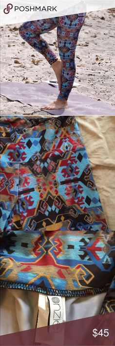 NWOT Onzie Print Leggings Never worn Onzie full length leggings. Had in two sizes & I have too many yoga pants! Very flattering, form fitting & stretchy. Perfect for hot yoga, even water sports because the material dries immediately. Size xs but would also fit a small. Onzie Pants Leggings