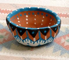 This is a pinch pot made of something that looks like earthware. It has a painted design that has dots and lines on it ~Eric Clay Pinch Pots, Ceramic Pinch Pots, Ceramic Clay, Clay Pots, Salt Dough Projects, Clay Art Projects, Clay Crafts, African Art Projects, Clay Studio