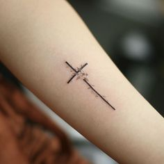 50 Small Tattoos With Meaning For Women Today,we invite you to discover some information related to women' tattoos with our guide. Collections of small meaningful tattoos for women. Cross Tattoo On Wrist, Small Cross Tattoos, Simple Cross Tattoo, Cross Tattoos For Women, Ankle Tattoos For Women, Ankle Tattoo Small, Back Tattoo, Cross Ankle Tattoos, Pretty Cross Tattoo
