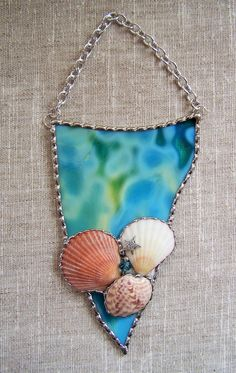 Items similar to Stained Glass Seashell Art on Etsy Stained glass shell artwork. Made in the Tiffany copper foil method. Stunning teal, lime and aqua colored art glass and decorative Stained Glass Angel, Stained Glass Ornaments, Stained Glass Suncatchers, Stained Glass Projects, Stained Glass Patterns, Seashell Art, Seashell Crafts, Seashell Candles, Starfish