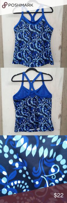 """♥Danskin Dri Tech Yoga Racerback♥ Hi Poshers! I'm selling this danskin Yoga Dri tech Racer back! It has a very cute and sporty design and a trendy racer back. Measurements arm pit to armpit 20"""" and from neckline to hem 19.5"""" size XL Danskin Now Tops"""