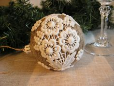 Handmade Rustic christmas ornament wrapped arround with old rope, and decorated with very old French cotton lace. A special and rare item. They look Rustic, little victorian but still decorated enough to catch someones eye...everything is made from recycled materials.
