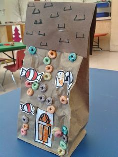 Such a cute & fun idea for my little ones! Classroom Freebies Too: Paper Bag Gingerbread Houses with Free Candy Printable