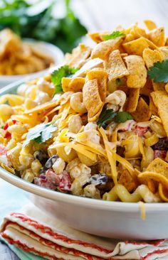 BBQ Ranch Pasta Salad with chicken and crunchy corn chips...this looks delicious, but I wouldn't use the bottled Ranch dressing, yuk, I would use 3/4 c. homemade Ranch and 1/4 c. BBQ sauce instead.