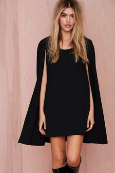 Under $100: A Sleek Black Cape Dress For Nights Out And Beyond