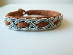 Lapland bracelet by Anita Gronstedt. Each one is made the same way they've been made by the Nordic region's indigenous Sami people for hundreds of years, out of soft reindeer leather, nickel-free pewter thread (including 4% silver), and a button made of naturally shed reindeer antler.