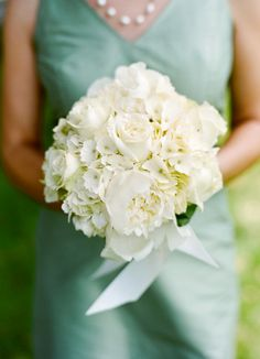 Teal bridesmaid dresses and white bouquet