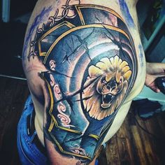 Blue Sleeve Tattoo Of Armor For Males With Yellow Lion