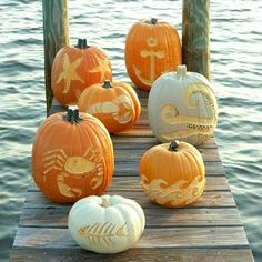 Carved pumpkins from Coastal Living. From crab to starfish to anchor, and more. http://www.completely-coastal.com/2012/10/decorated-pumpkins-ideas.html