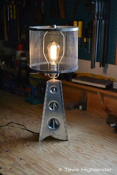 Aluminum sheet metal, buck riveted, punch flared, aviation inspired lamp. industrial style furniture