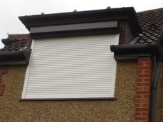 Foam Filled Roller Shutter fitted externally to the side window of a private residential property in Knightsbridge Rolling Shutter, Plots For Sale, Universal Remote Control, Roller Shutters, Shutter Doors, Side Window, Skylight, Portal, Blinds