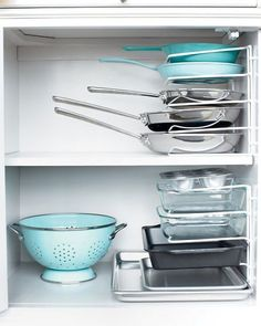 Storage for Pans and Baking Dishes. Put organizer on back wall to allow for storage in the remainder of the cabinet.