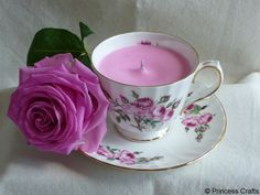 A candle in a tea cup by Princess Crafts